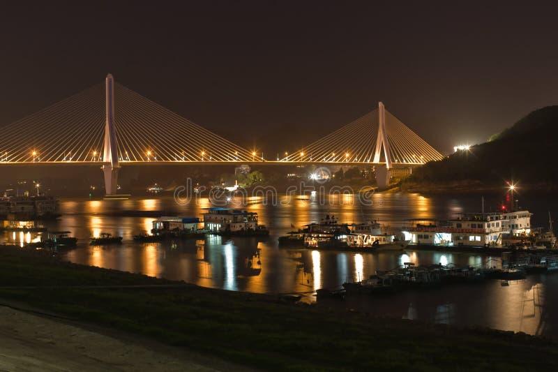 Bridge and boats at night