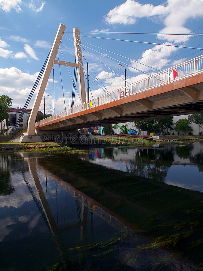 Bridge of Bydgoszcz. Reflected in the water road bridge over the River Brda in Bydgoszcz stock photo