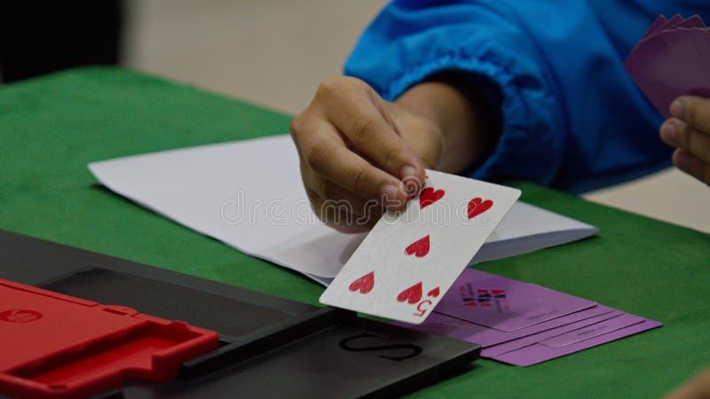 Bridge card game, during the Thailand National Games, Chiang Rai Games. Chiang Rai, Thailand - November 19, 2018 : Bridge, a four-player partnership trick royalty free stock image