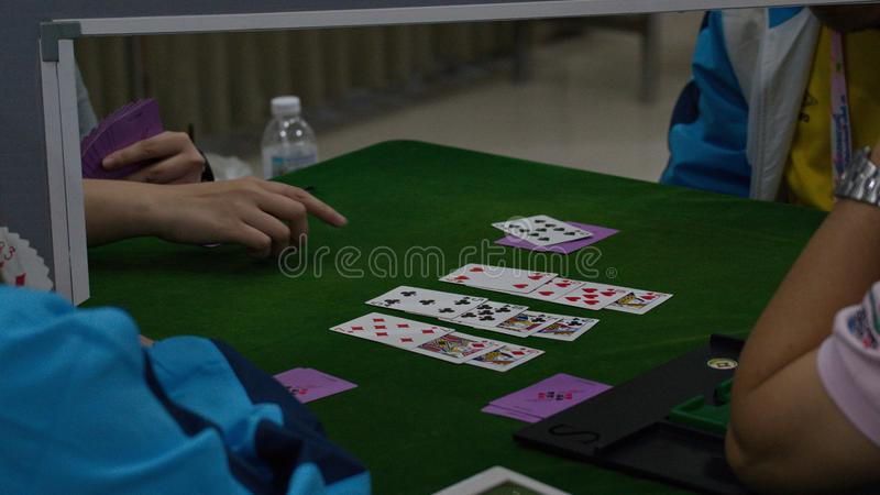Bridge card game, during the Thailand National Games, Chiang Rai Games. Chiang Rai, Thailand - November 19, 2018 : Bridge, a four-player partnership trick royalty free stock photography
