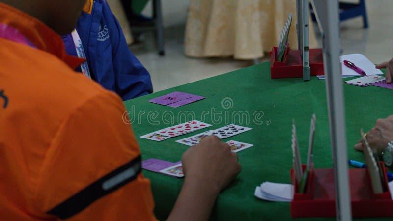 Bridge card game, during the Thailand National Games, Chiang Rai Games. Chiang Rai, Thailand - November 19, 2018 : Bridge, a four-player partnership trick royalty free stock photo