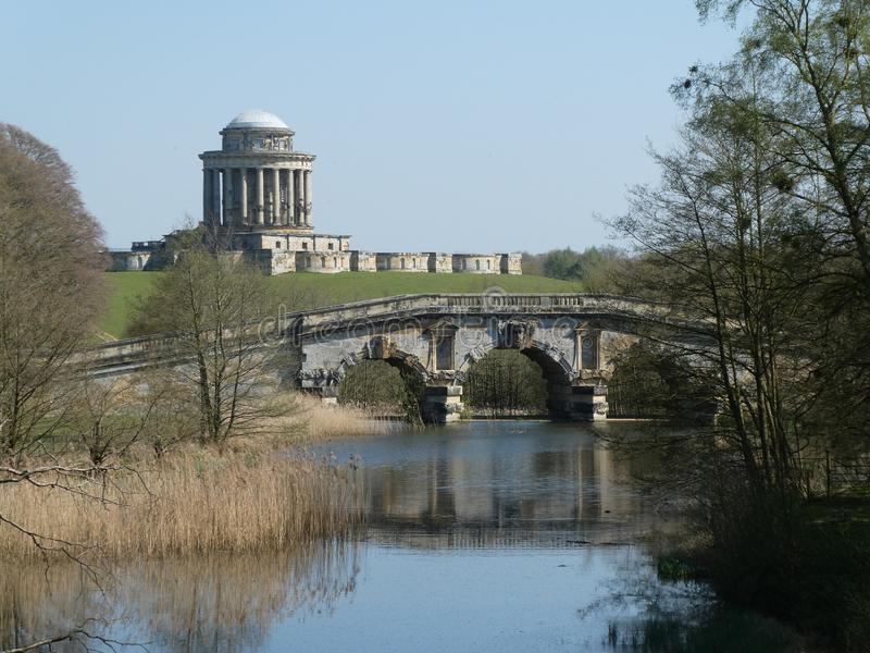 Bridge at Castle Howard in the sun. Bridge at Castle Howard on a warm April day. With the sun on it, highlighting the Architecture stock photo