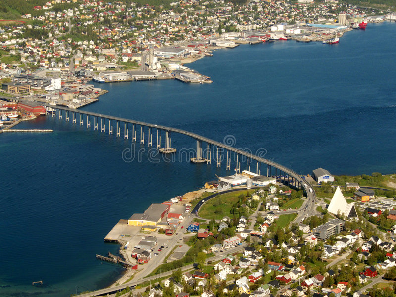 The bridge and the Cathedral of Tromsoe. The bridge and the polar sea Cathedral in Tromsoe, Northern Norway royalty free stock photography