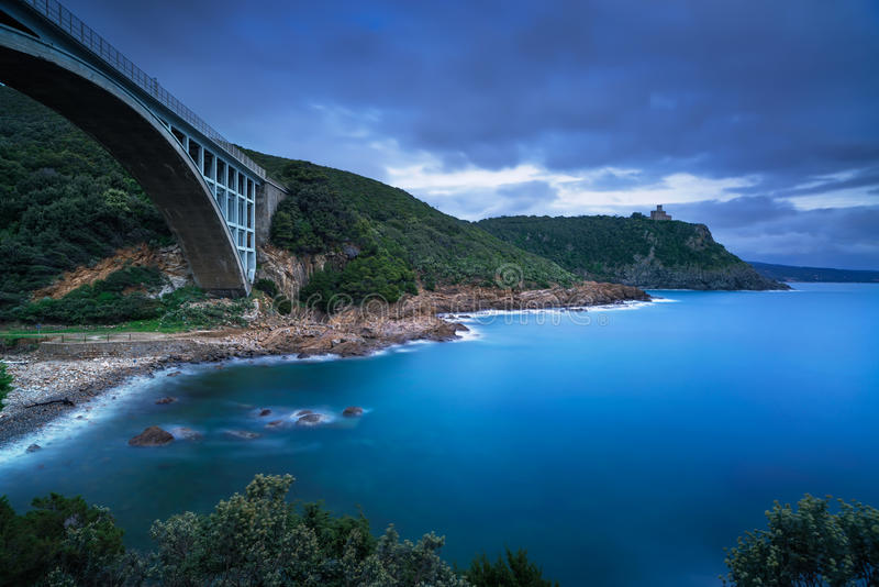 Bridge, cliff and sea. Leghorn coast, Tuscany riviera, Italy. Bridge, cliff and sea. Leghorn coast, Tuscany riviera Italy, Europe. Long Exposure stock photo