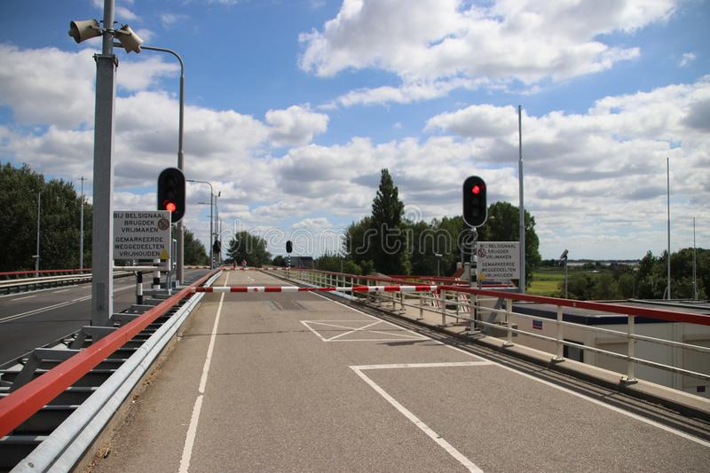 Bridge closed with barriers at the Prinses Margrietsluis sluice complex in the town of lemmer royalty free stock image