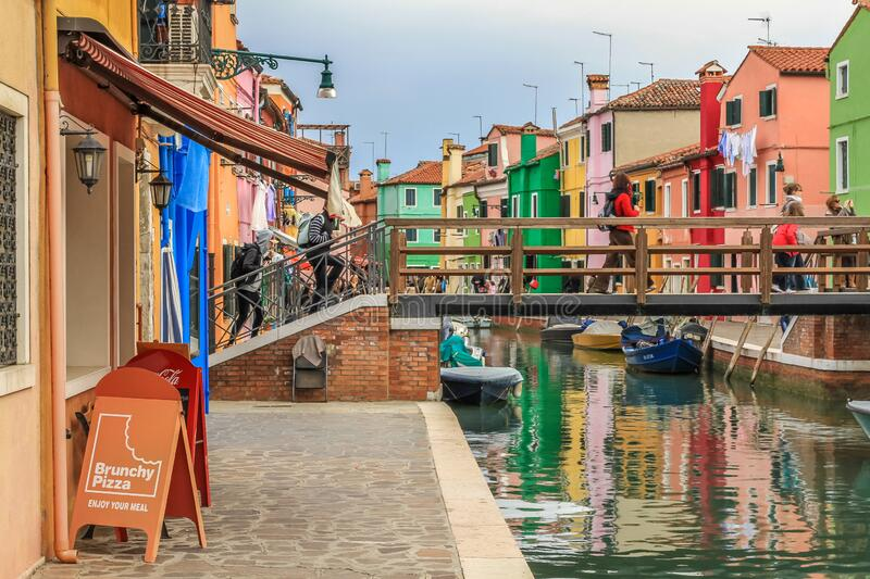 Wooden bridge in colourful Burano in the Venetian lagoon royalty free stock photos