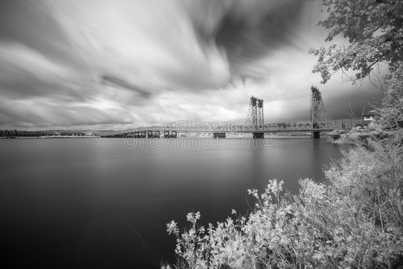 The bridge crosses the Columbia River. This is an infrared long exposure photograph taken next to Columbia river stock photography
