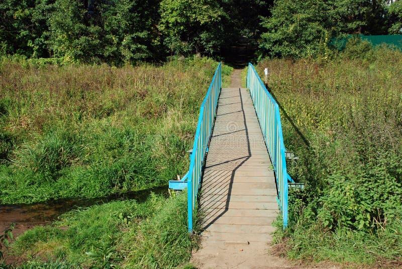 The bridge for crossing the Creek. stock photos