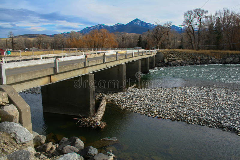 Bridge crossing over river with low water stock photography