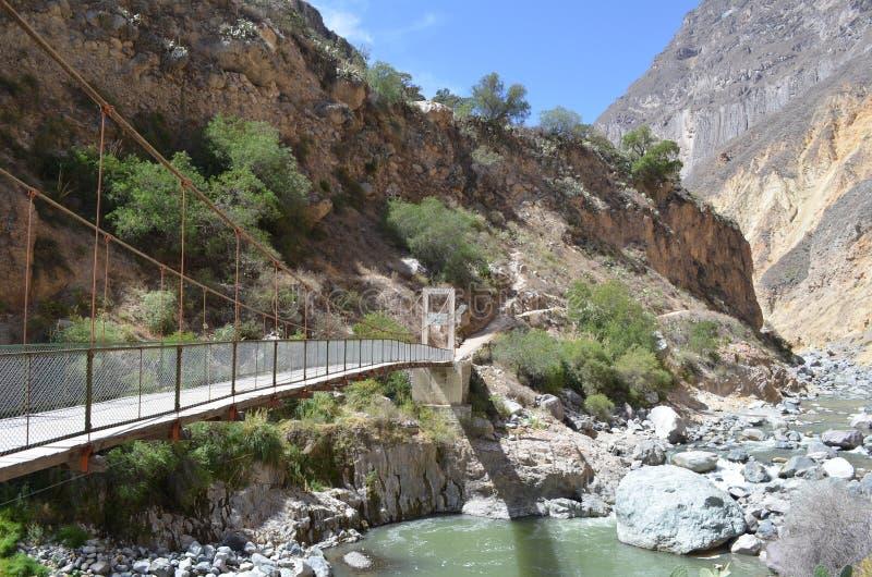Bridge crossing the river on bottom of Colca Canyon. Peru royalty free stock image