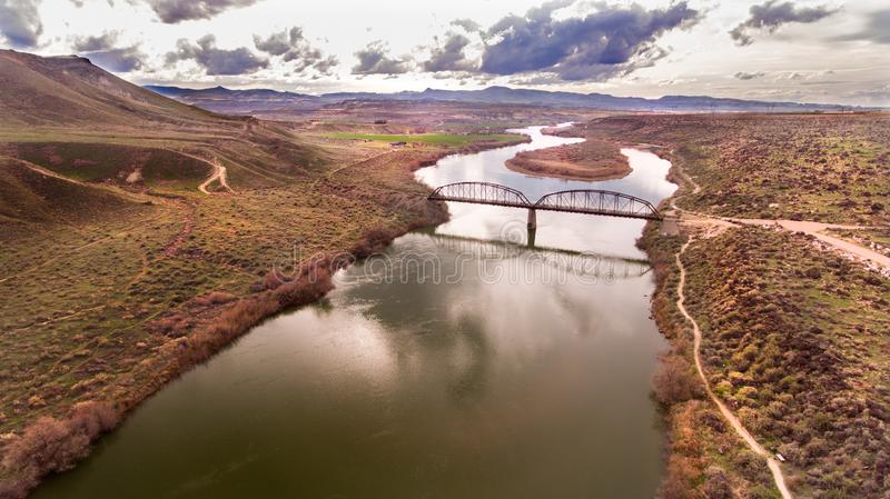 Bridge crossing a river in idaho shot from a drone stock photos