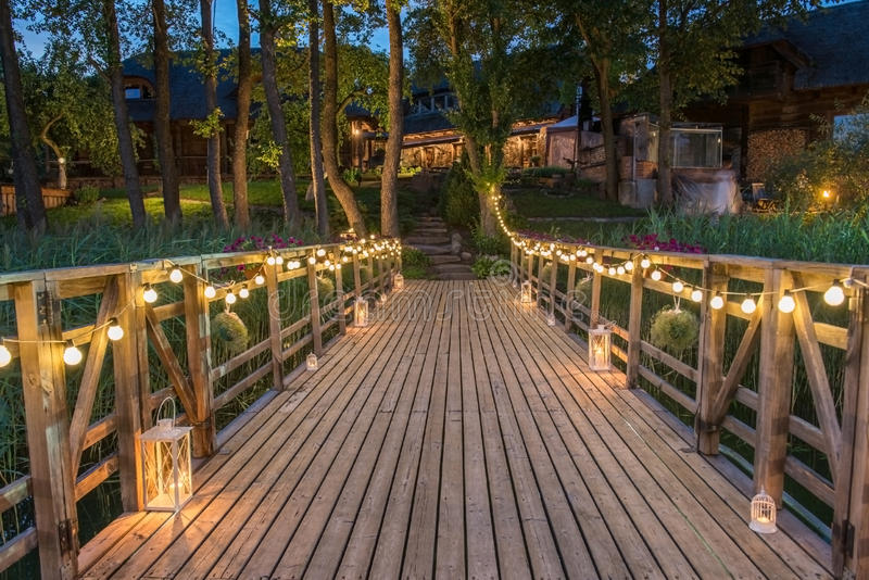 Bridge decorated for wedding. Ceremony with lights, evening time stock image