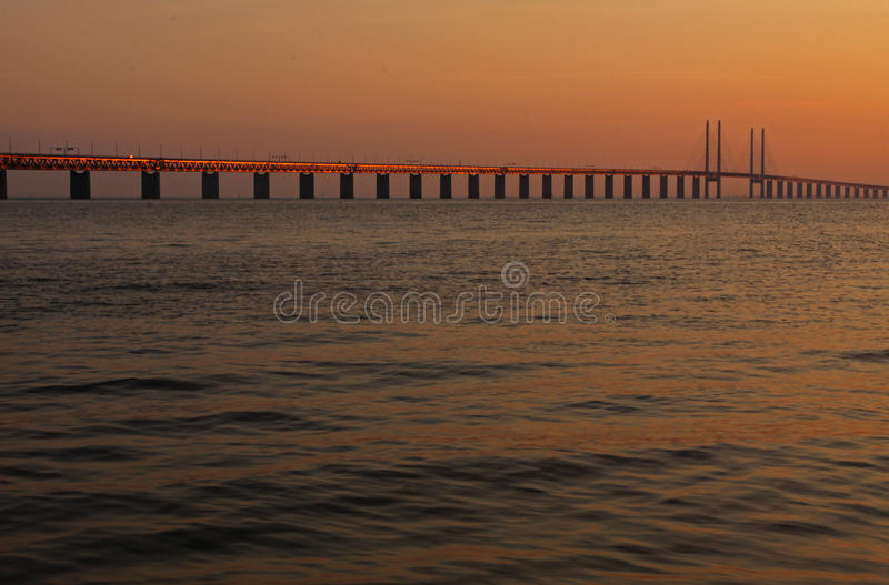 Bridge between Denmark and Sweden. The bridge between Scania (Sweden) and Zealand (Denmark) during sunset. Image taken fron the side of Sweden royalty free stock image