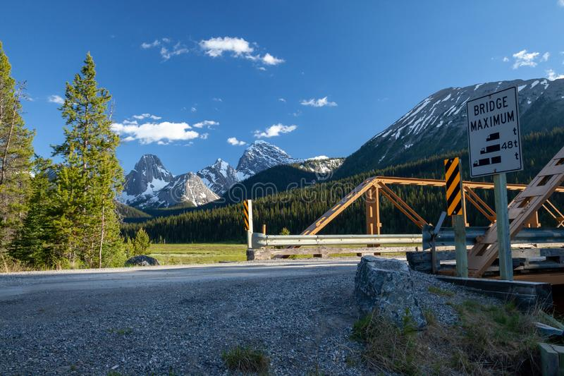 A bridge on a dirt road in Kananaskis in the Canadian Rockies stock image