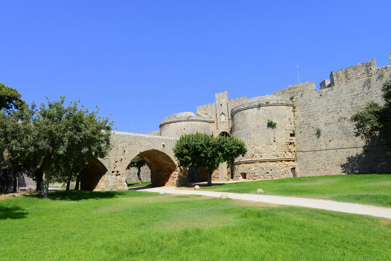 Bridge entrance into Rhodes fortified citadel. The outside walls of Rhodes castle stock photos