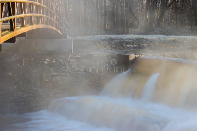 Bridge extending over a dam stock images