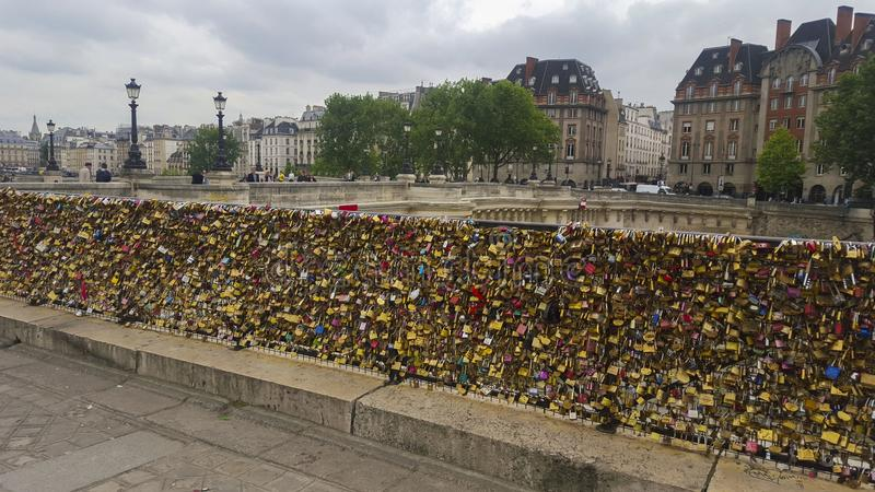 Bridge fence in paris with padlocks royalty free stock images