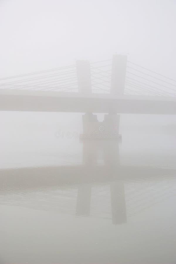 Bridge In The Fog. Silhouette of the modern concrete bridge in the fog