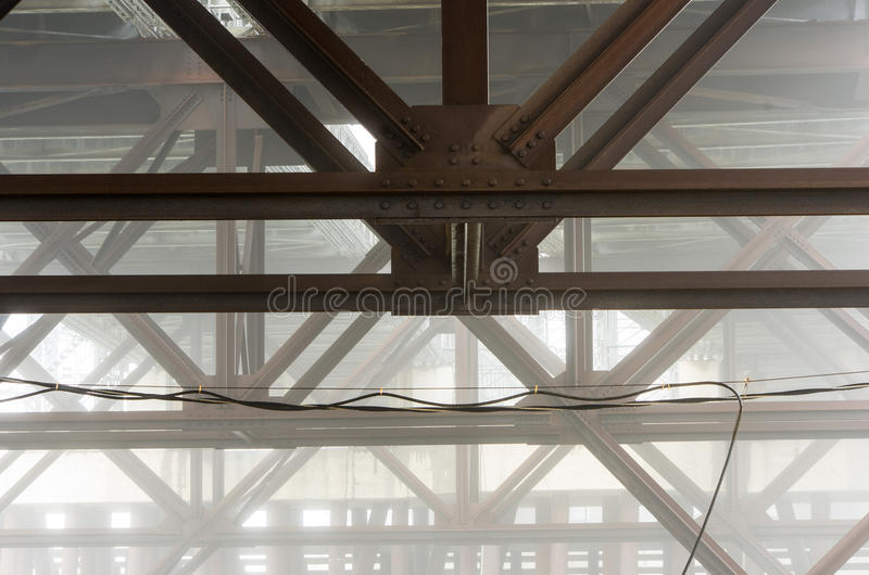 Bridge girders in fog. The bridge supports of the Fore River Bridge in Weymouth Ma on a foggy day stock images