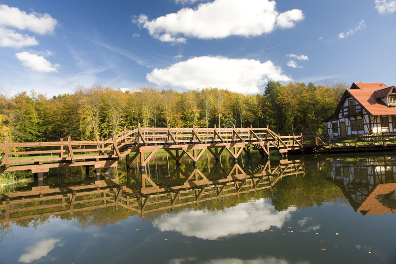 Bridge and house in woods stock image
