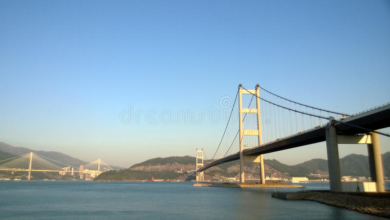 Bridge. An Industrial Landscape....a bridge connecting islands is a means of industrial transportation and commutation as well stock photos