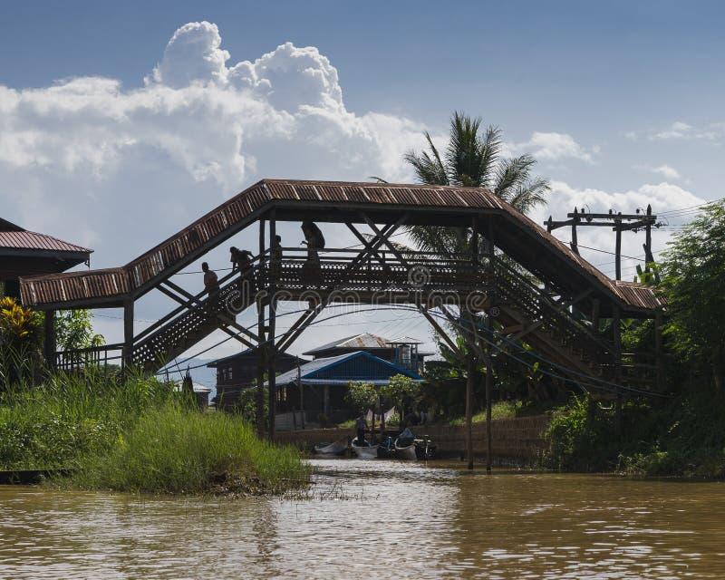 Bridge on the Inle lake. People on the Bridge in Exotic Floating village at Inle Lake, Myanmar royalty free stock images