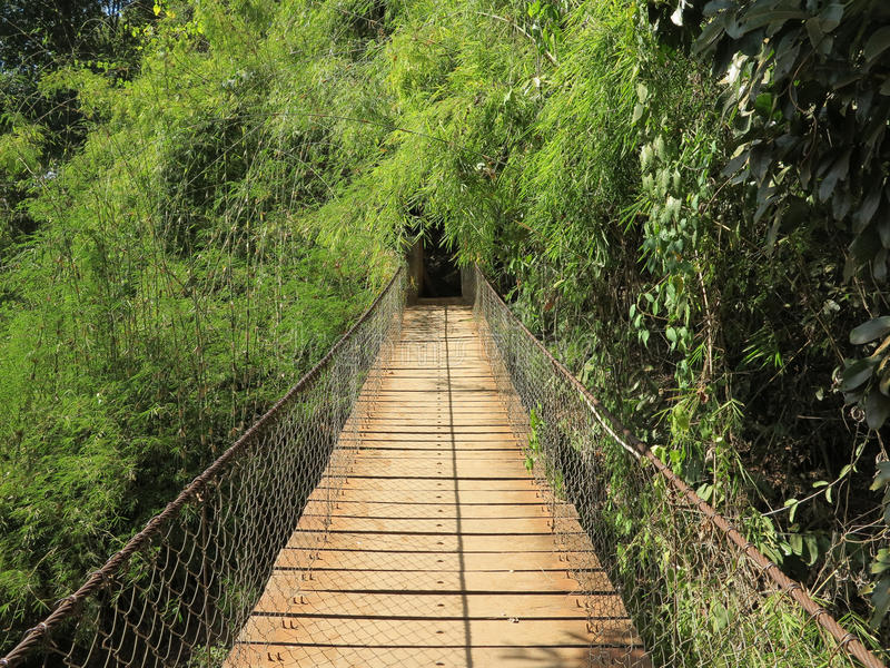 Bridge at Ka Chang waterfalls. Rough bridge at Ka Chang waterfalls in Cambodia royalty free stock photography