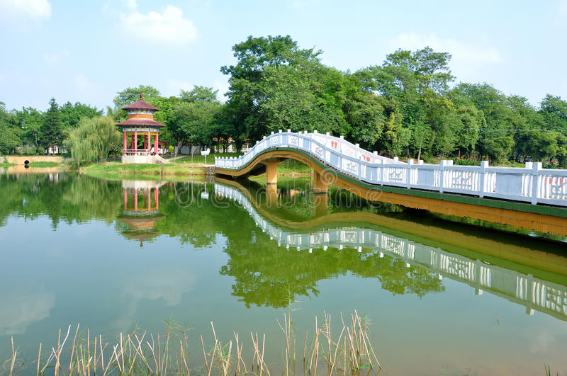 Bridge and lake. Bridge and the park pavilion, a clear reflection stock photography