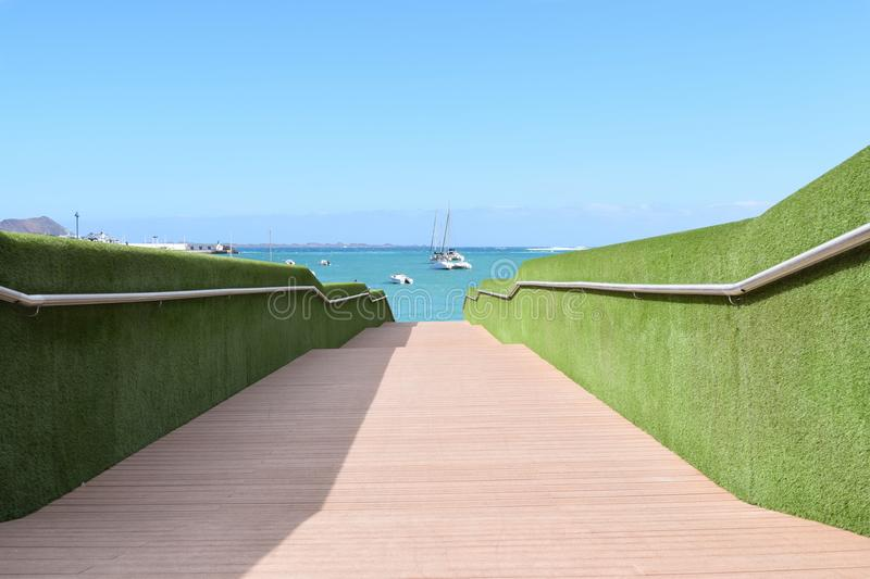 Bridge leading to the ocean royalty free stock photo