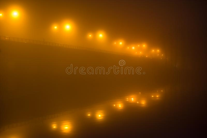 The bridge leads use into the darkness stock image