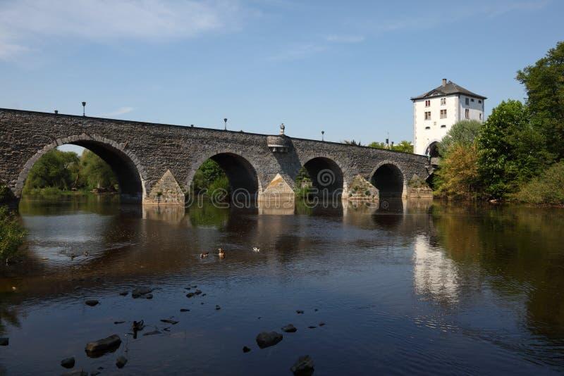 Bridge in Limburg, Germany. Ancient bridge over the Lahn river in Limburg, Germany stock images