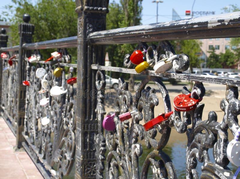 Bridge of lovers in Astrakhan. Lock on happiness on the bridge of lovers in the Russian city of Astrakhan stock images