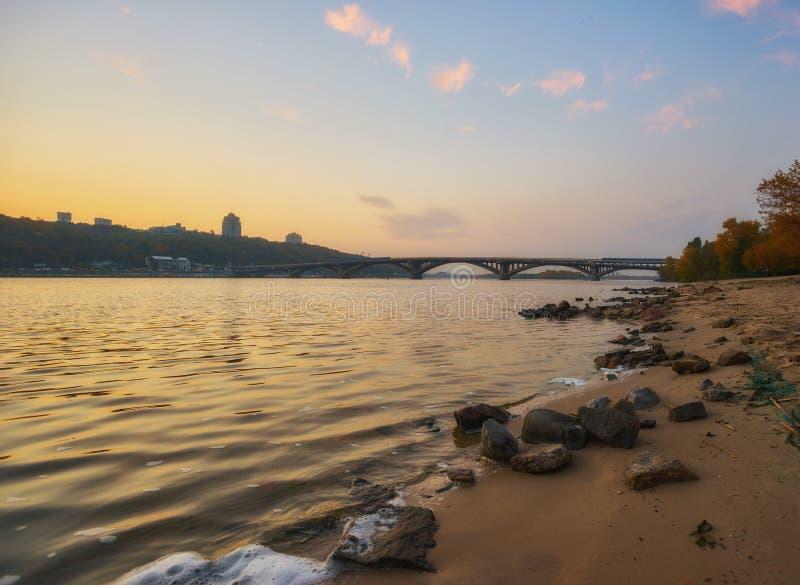 Bridge metro across the Dnieper River in Kiev. The metro train rides the bridge. Autumn, background, city, landscape, ukraine, urban, water, architecture, bank stock photo