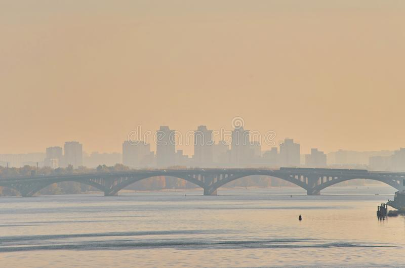 Bridge metro across the Dnieper River in Kiev. The metro train rides the bridge. Autumn, background, city, landscape, ukraine, urban, water, architecture, bank royalty free stock photo
