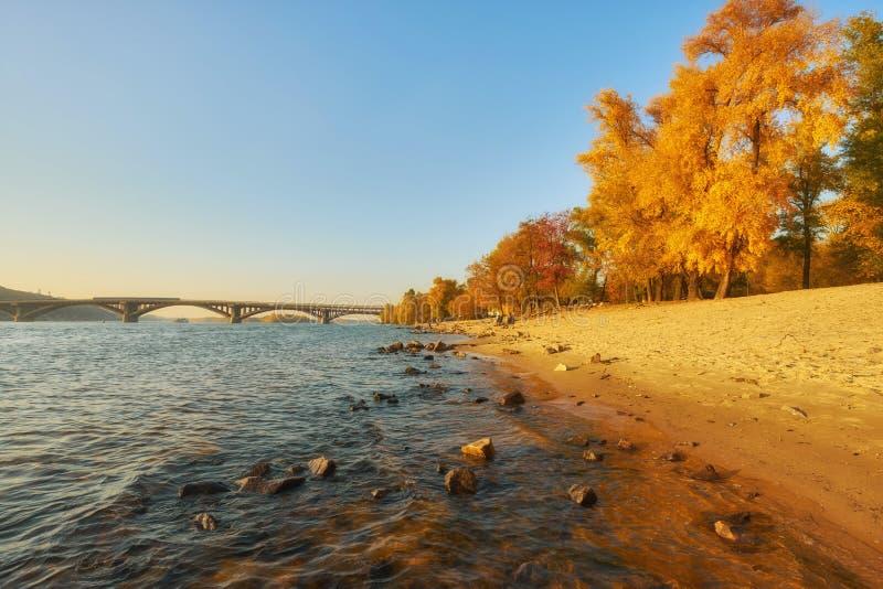 Bridge metro across the Dnieper River in Kiev. The metro train rides the bridge. Autumn, background, city, landscape, ukraine, urban, water, architecture, bank royalty free stock photography