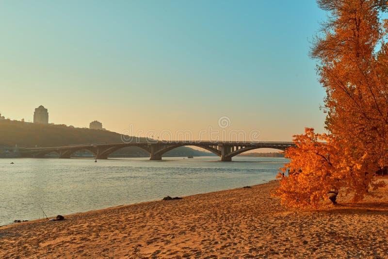 Bridge metro across the Dnieper River in Kiev. The metro train rides the bridge. Autumn, background, city, landscape, ukraine, urban, water, architecture, bank royalty free stock image