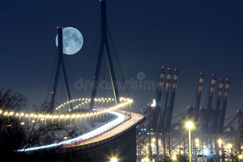 Bridge moonlight. Koehlbrandbridge in port of Hamburg under moonlight royalty free stock image