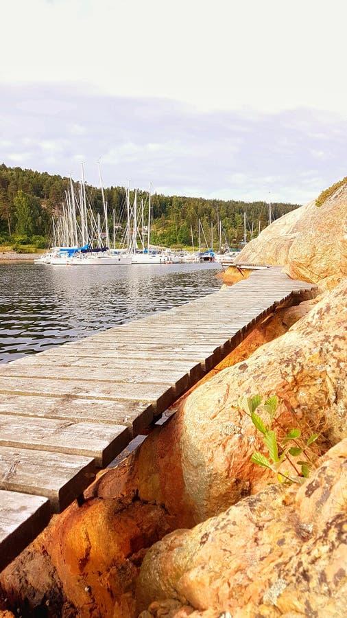 Bridge by mountain wall royalty free stock image