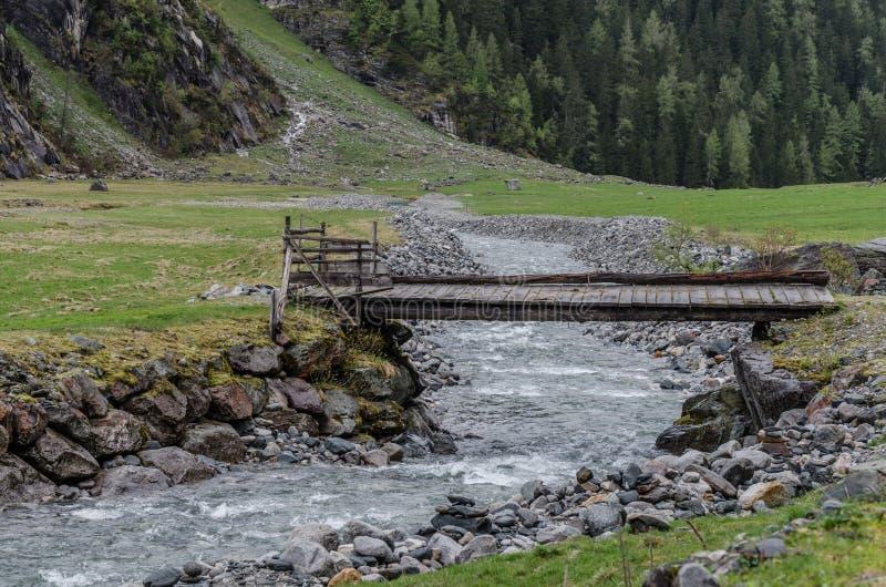 bridge in the mountains stock photo