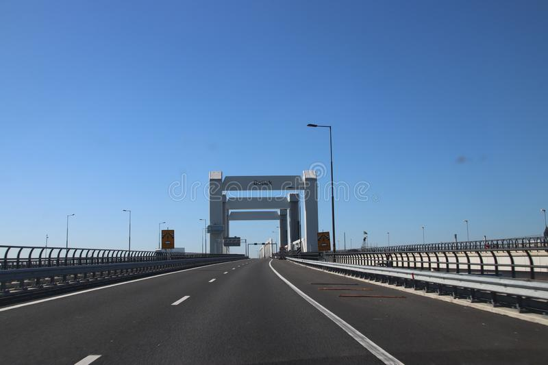 Bridge named Botlekbrug on motorway A15 in the Botlek harbor in Rotterdam, The Netherlands royalty free stock photography