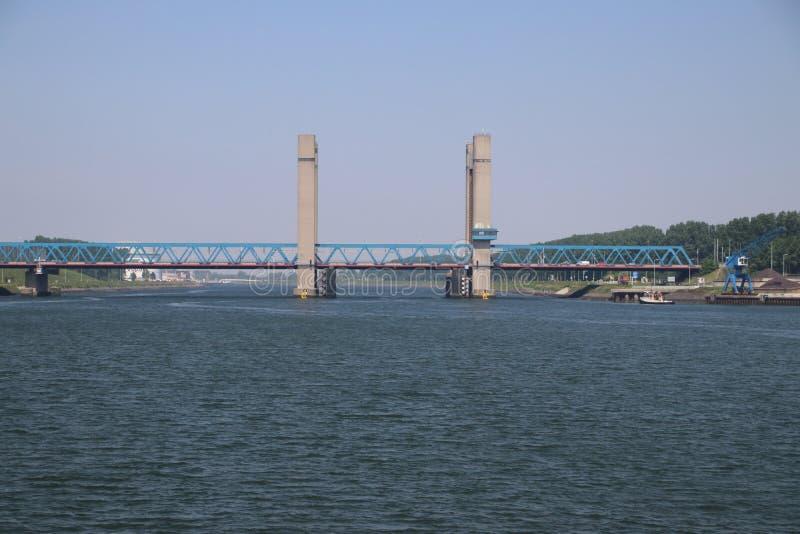 Bridge named Calandbrug in the harbor of Rotterdam over Caland canal. stock photo