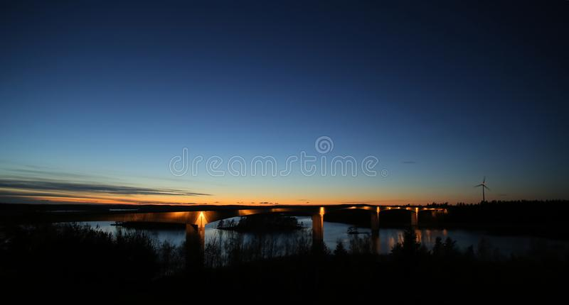 Bridge near Askersund over northern part of the lake Vaettern in Sweden, during night.  royalty free stock image
