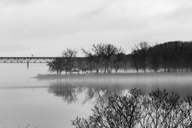 Bridge to Park in the Fog royalty free stock photography