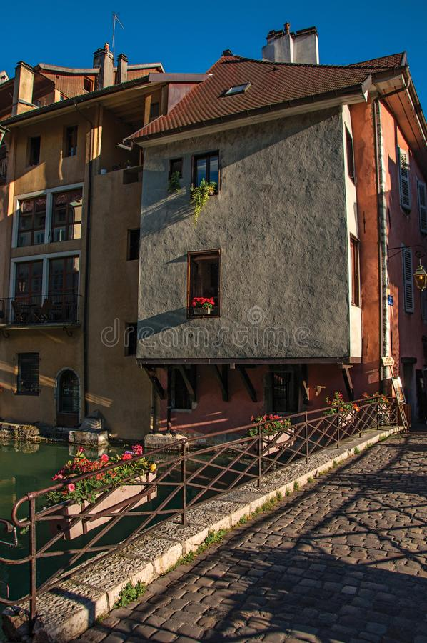Bridge and old buildings facing the canal at sunset in Annecy. Bridge and old buildings facing the canal at sunset, in the city center of historic Annecy stock photography