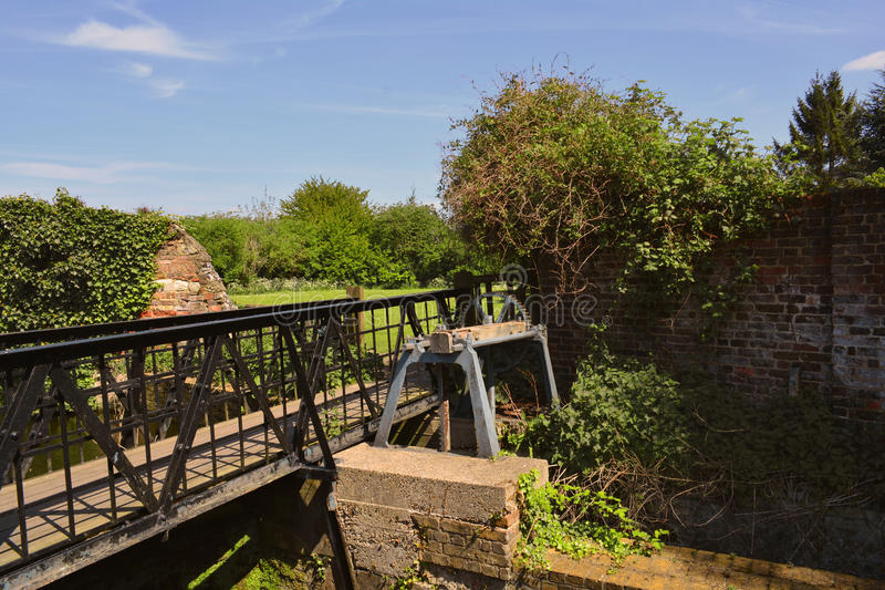 Bridge and old canal lock on the river Lee near Waltham Abbey ruins, UK. Waltham Abbey is a market town of about 20,400 people in Epping Forest District in the stock images