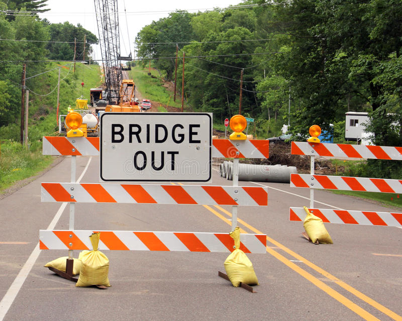 Bridge out sign on a road barricade. Road closed with a bridge out sign on a barricade stock photography