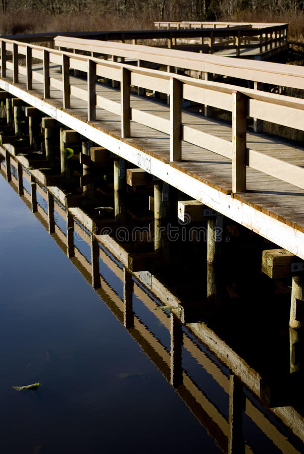 Free Bridge Over A Still Pond Royalty Free Stock Photos - 14415658