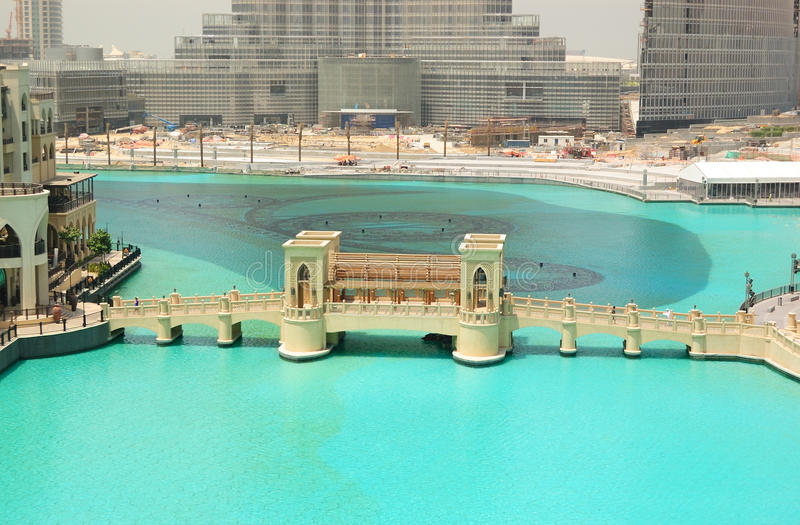 Bridge over artificial lake in Dubai downtown. In front of Burj Dubai skyscraper and dancing fountains, UAE royalty free stock photo