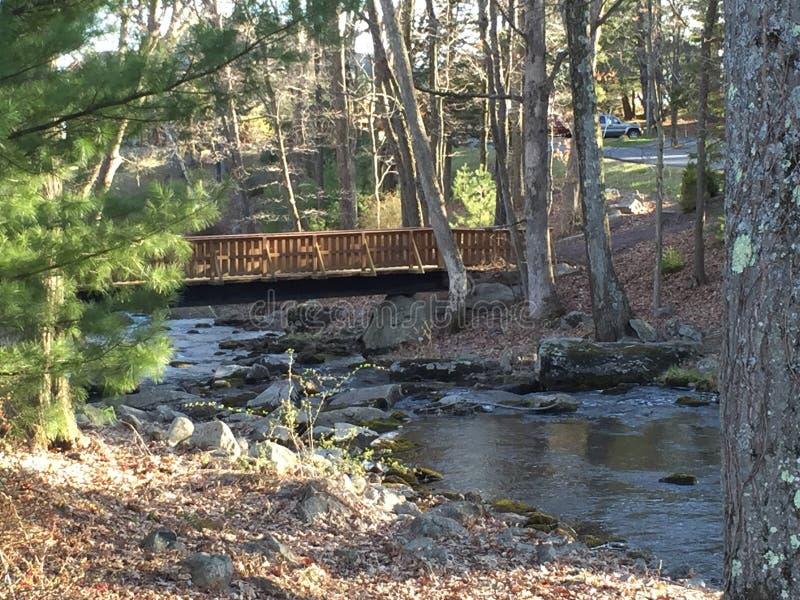 Bridge over babbling brook royalty free stock photos