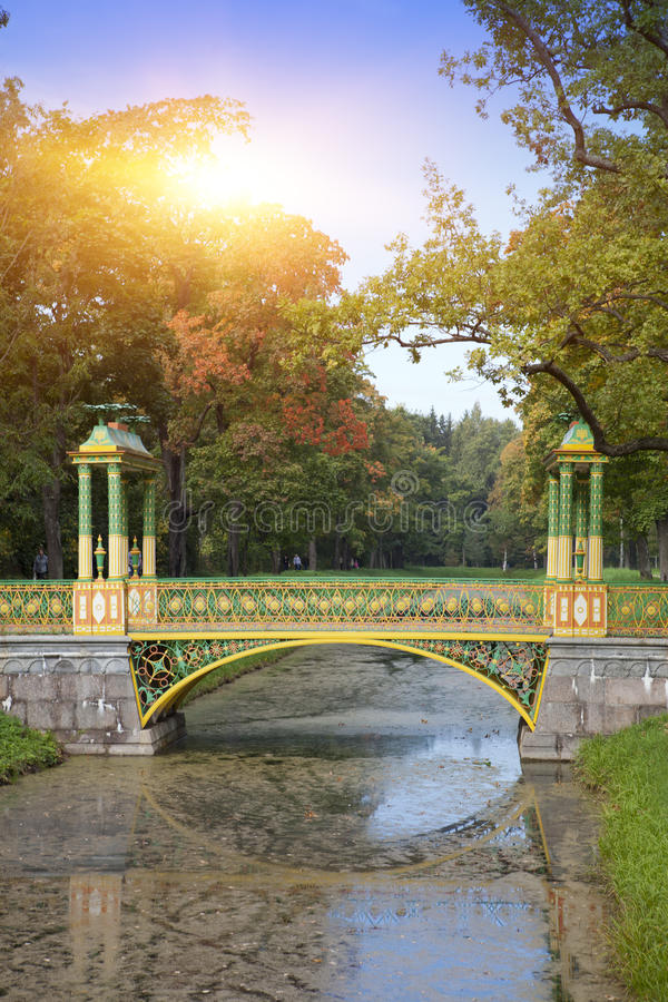The bridge over the channel overgrown with a duckweed. Catherine Park. Pushkin Tsarskoye Selo. Petersburg.  royalty free stock photo